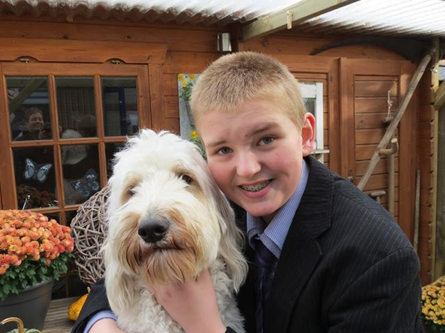 Boy with his Australian Labradoodle