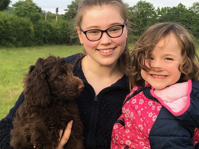 Grace, Lisa Carson's family with labradoodle puppy